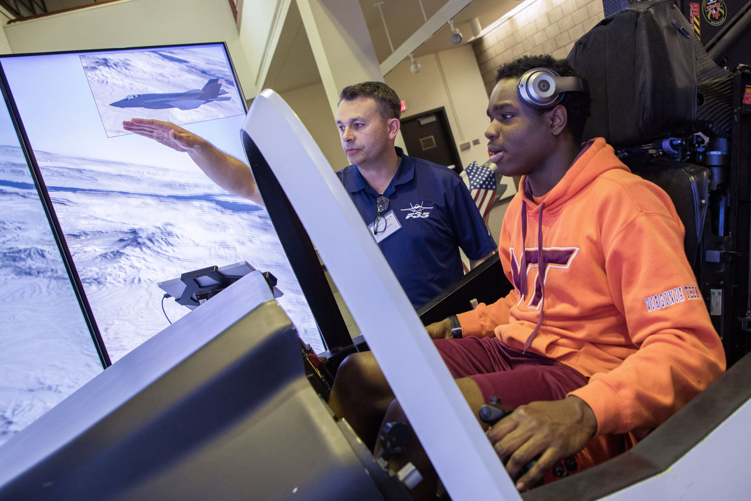 Virginia Tech student on a Lockheed Martin flight simulator.