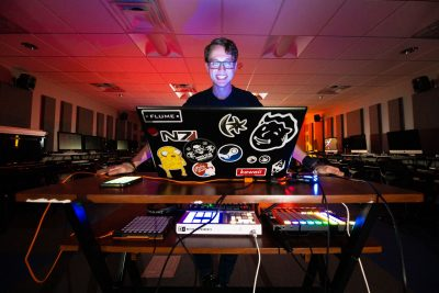 Virginia Tech student making music on his laptop.