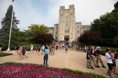 Students walking around outside of Burruss Hall.