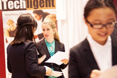 Female grad students at a career fair.