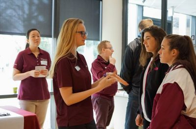 A Virginia Tech student talks with prospective students.