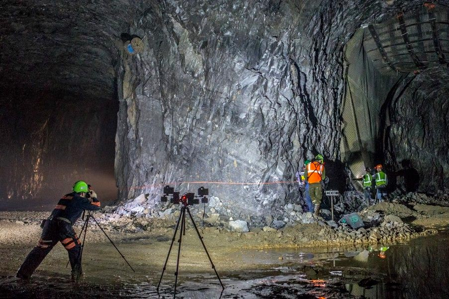 Mining students use a laser to measure the inside of a mine.