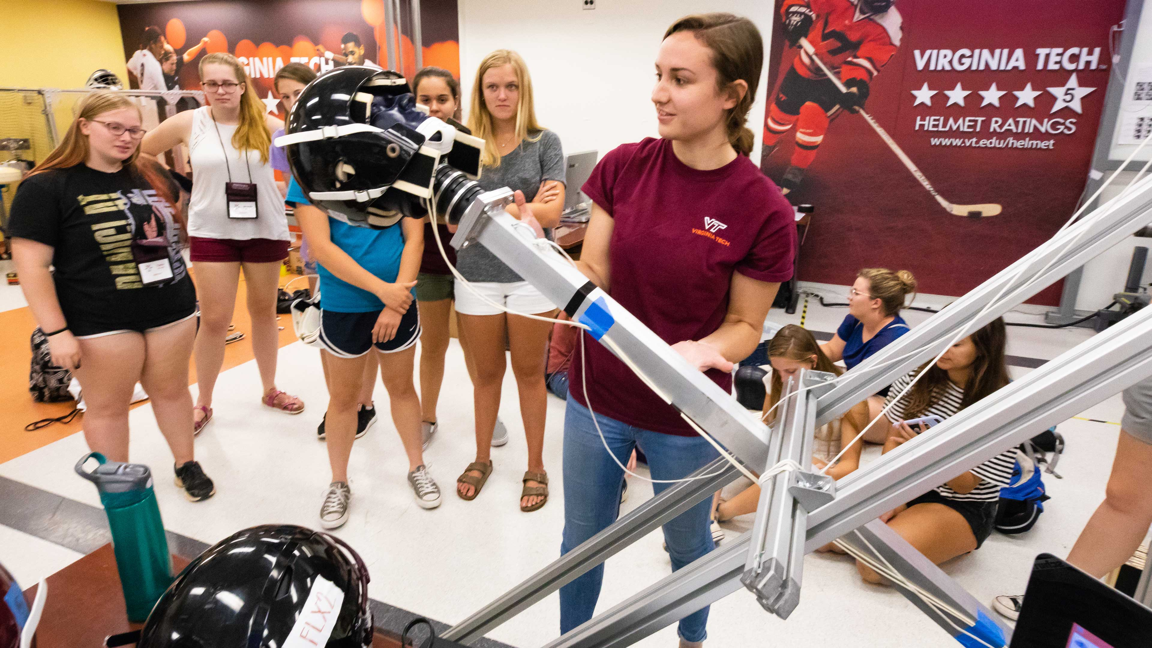Students watching a helmet drop in the Virginia Tech BEAM Helmet Lab
