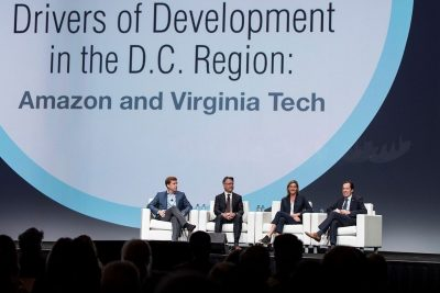 A panel of people on stage present the Amazon and Virginia Tech connection.