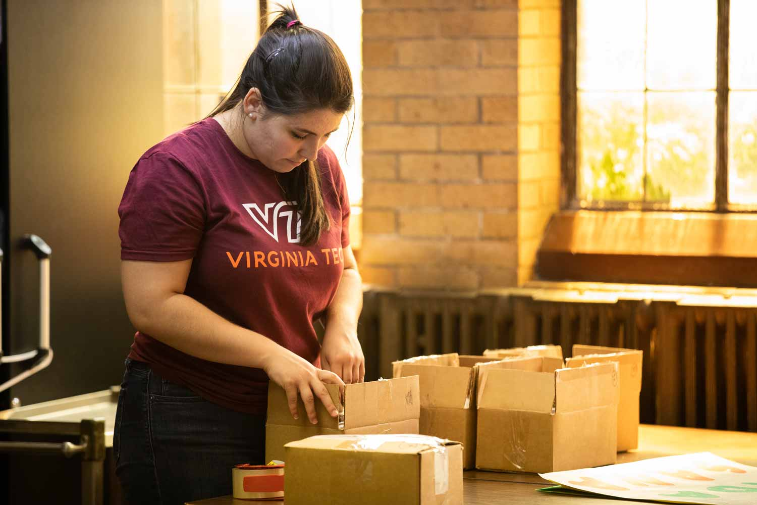 A Virginia Tech grad student prepares water sample kits in the basement of a church.