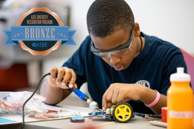 Young man working on a robotic vehicle.