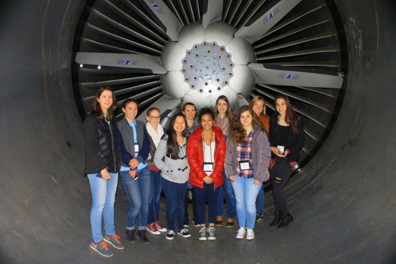 Students standing in jet engine