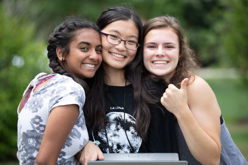 Three smiling girls at C-Tech^2 summer program