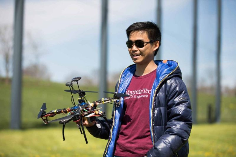 Kevin Yu holds a drone in the Virginia Tech drone park.