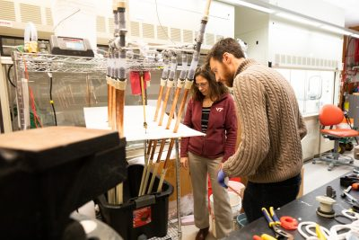 Amy Prudent works with a student in her lab.