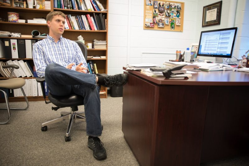 Jonathan Boreyko sitting in a chair in his office.